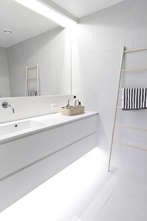 fill your white bathroom with light hiding some of them above