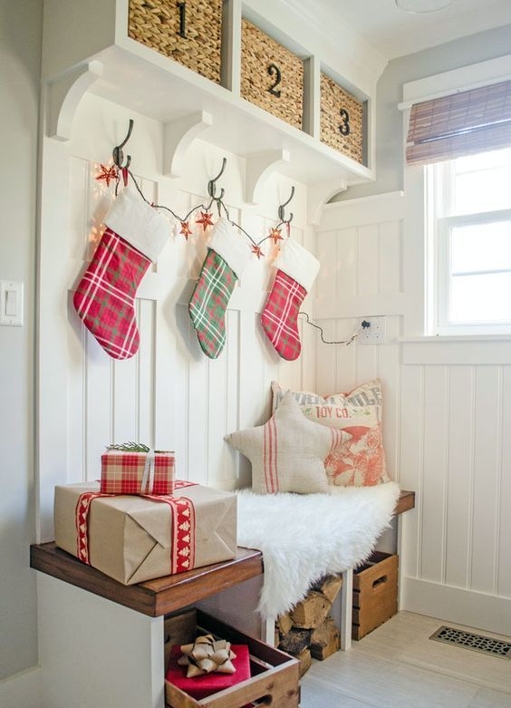 make your guests feel the coming of Christmas using a stocking garland and some gift-looking boxes