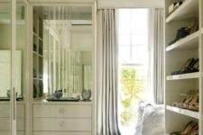 12 mirror doors of the wardrobes will help to visually enlarge the space reflecting the light