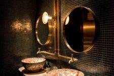 12 small black tiles, brass details and unique patterned sinks