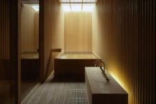 13 bathroom totally clad with light wood with hidden lights look relaxing and a bit mysterious