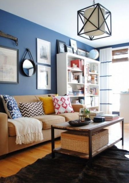 brown and beige furniture, a bold blue accent wall for an eye catchy look