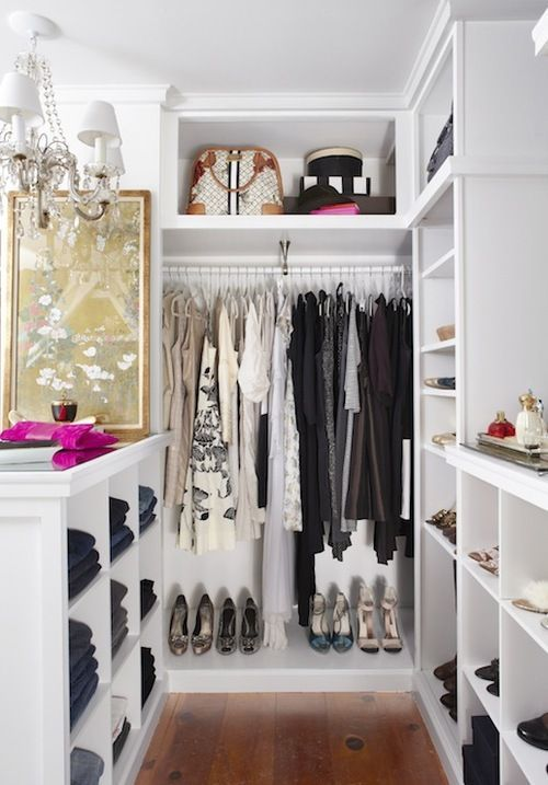 functional tiny closet with a clothes rack and open shelving for shoes and accessories