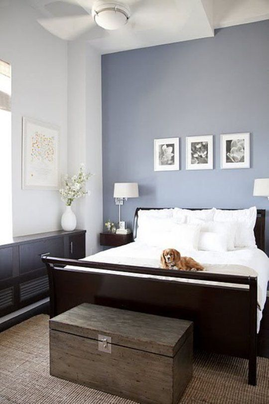 lavender accent wall gives this neutral bedroom a girlish feel