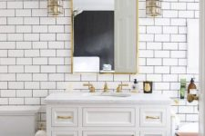 13 white subway tiles look cool with gold accents