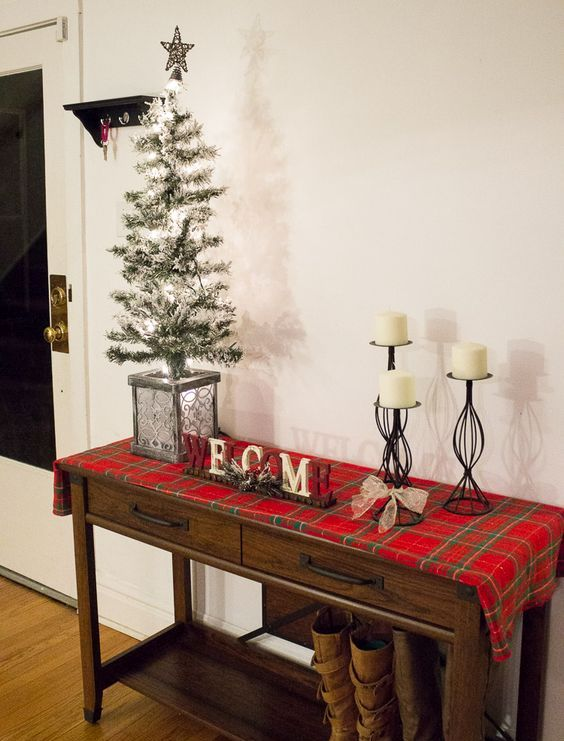 cover your console table with plaid fabric, add candles and a faux Christmas tree