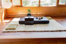 14 minimalist floor table in matte black and a floor carpet