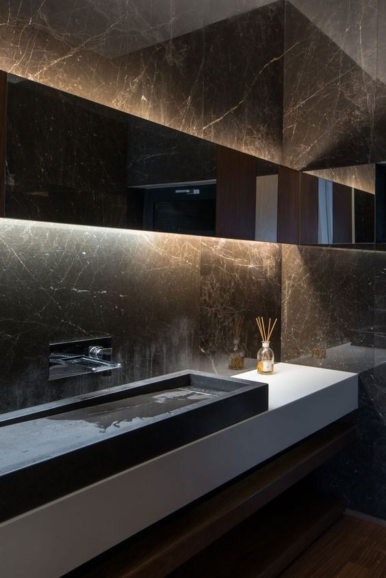 this moody space plays because of black marble walls