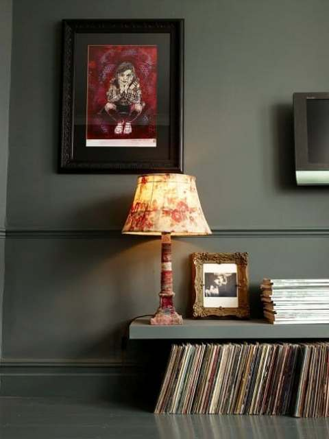 a dark Lack shelf hung just high enough above the dark hardwood floor to allow for record storage underneath