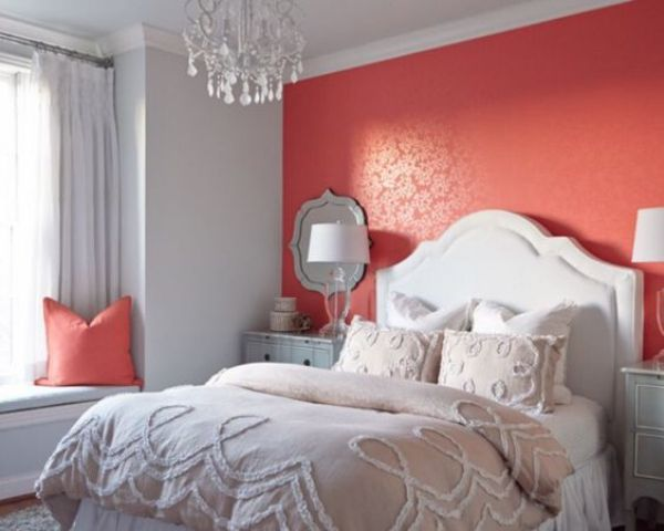 a coral accent wall will add a bit of passion to your bedroom