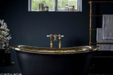 15 charcoal grey bathroom with brass accents and a retro free-standing bathtub