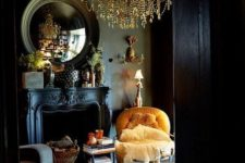 15 elegant neoclassic living room with black walls, an antique fireplace and a gold chandelier