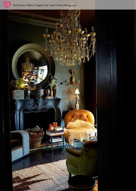 elegant neoclassic living room with black walls an antique fireplace