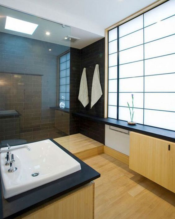 minimalist Japanese bathroom with black tiles and light woods