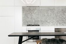 15 minimalist white kitchen is spruced up with grey tiles of various tones