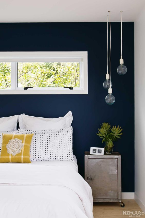 navy accent wall for a neutral guest bedroom