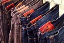 15 organize your jeans, pants and tank tops in the closet using hooks