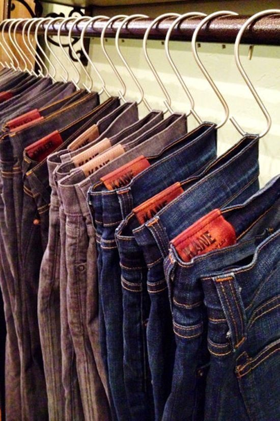 organize your jeans, pants and tank tops in the closet using hooks