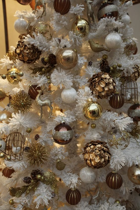 vintage inspired gold ornaments in a faux white tree - White And Gold Christmas Ornaments