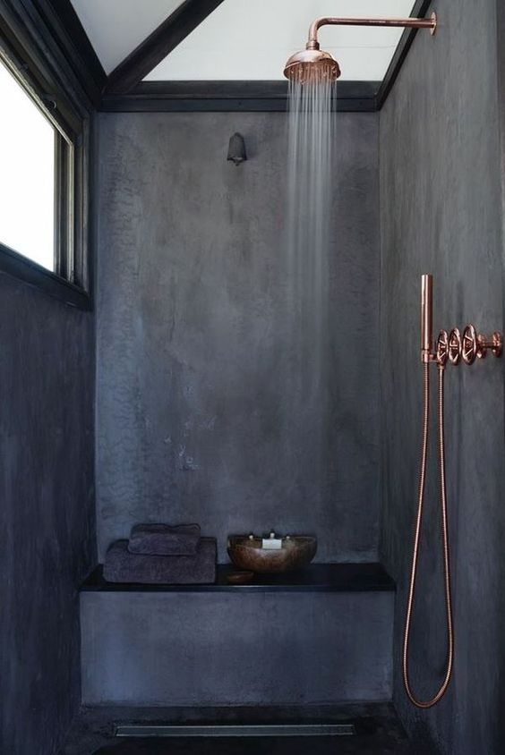 dark grey shower space with copper touches