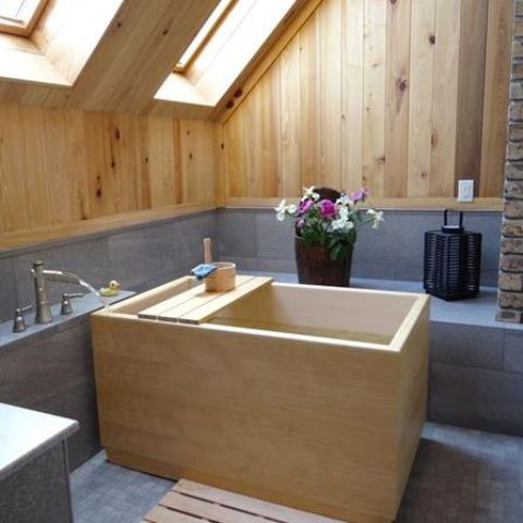 light wood on the walls and ceiling echo with a traditional ofuro wooden bathtub