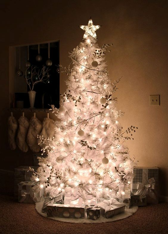 silver and white Christmas tree with ball ornaments