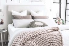 17 a chunky knit wool throw adds texture and interest to this neutral bedroom