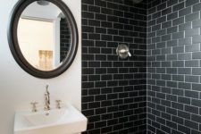 17 black subway tiles in the shower for a masculine bathroom