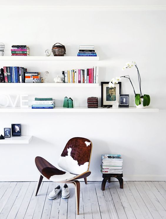 calm mid century modern space with Lack shelves for storage