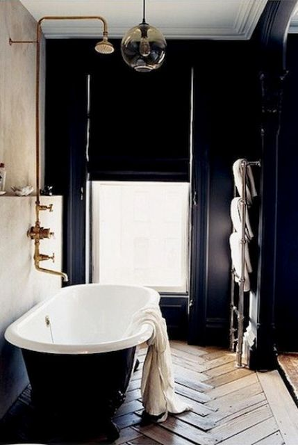 elegant art deco bathroom with a window for a view and a parquet floor