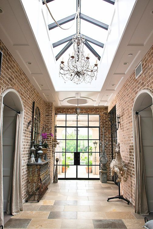 raised roof with the large skylight, arched brick doorways for a refined entryway
