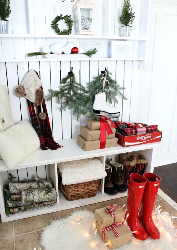 red rainboots and gift boxes for a winter hallway