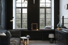 17 small dark sitting room, chic modern furniture and a unique brass chandelier