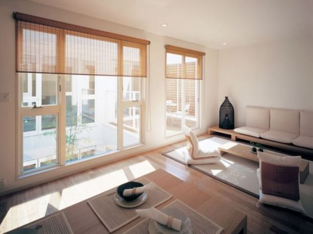 Modern Japanese Living And Dining Space With Large Windows And Mabmboo  Shades
