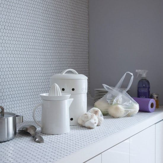 a whole countertop covered in penny tiles, a coved transition into a penny tile backsplash