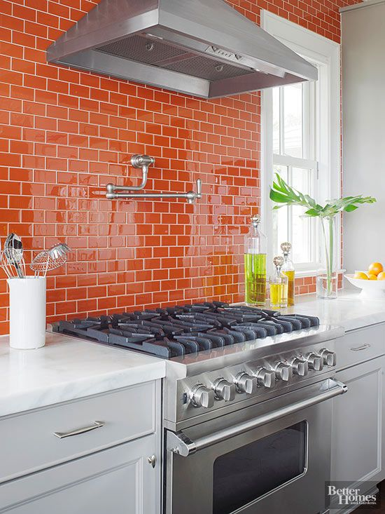 bold orange kitchen backsplash and wall covered in offset pattern
