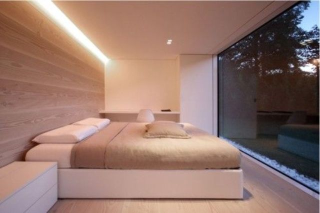 hidden lighting above the bed provides additional light for reading