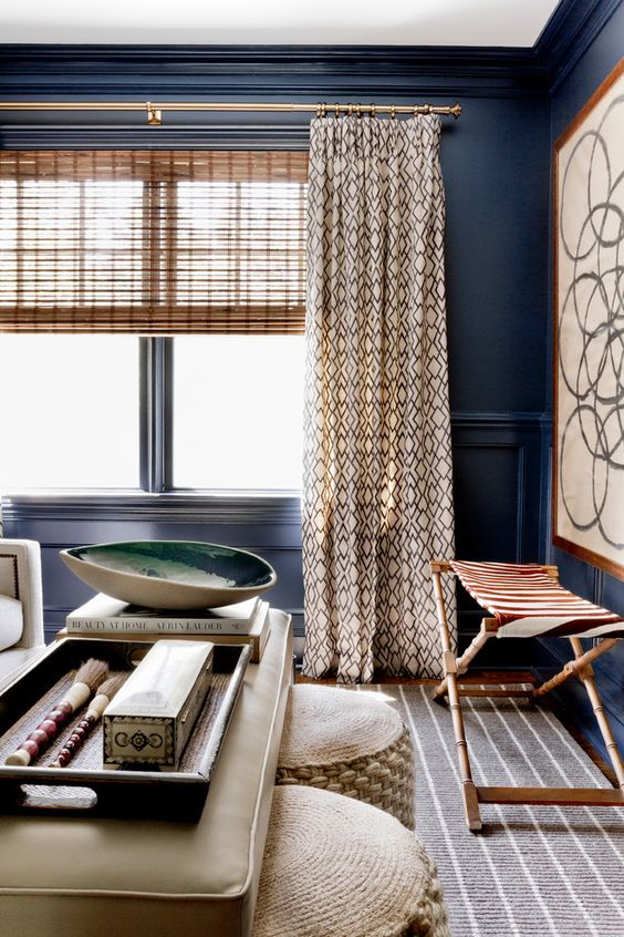 textural decor in neutral beige and brown, blue walls
