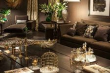 20 dark chocolate living room with metallic accents and greenery