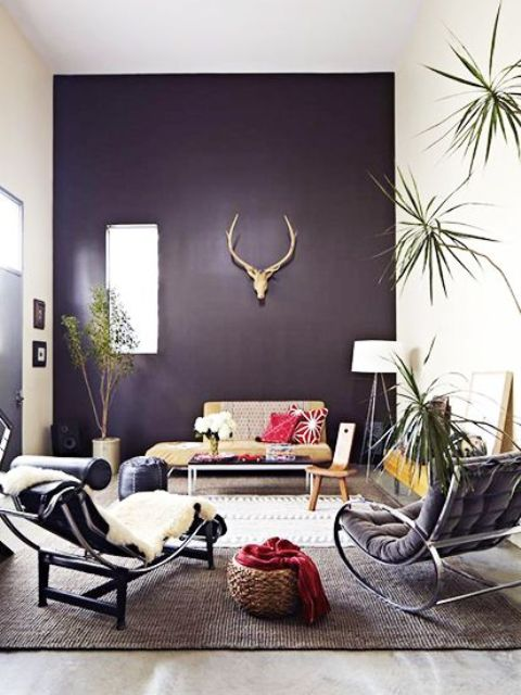 dark purple accent wall accentuates this living room and makes it  mysterious and unique
