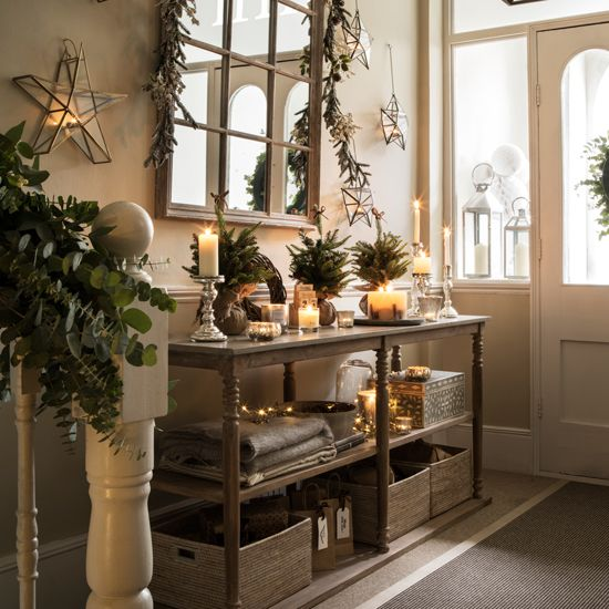 eucalyptus, evergreen branches, 3D stars and lights make the entryway Christmas-like