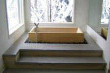 minimalist bathroom design with a wooden soaking bathtub