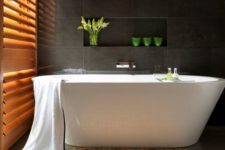 20 serene and luxurious, this Zen bathroom centres around a freestanding tub