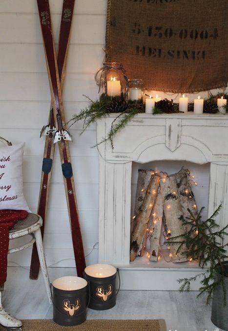 faux fireplace with candle lanterns and firewood decorated with lights