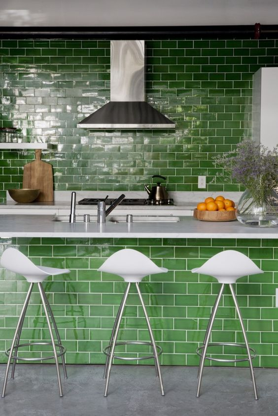 grass green subway tiles as a  backsplash and on the kitchen island