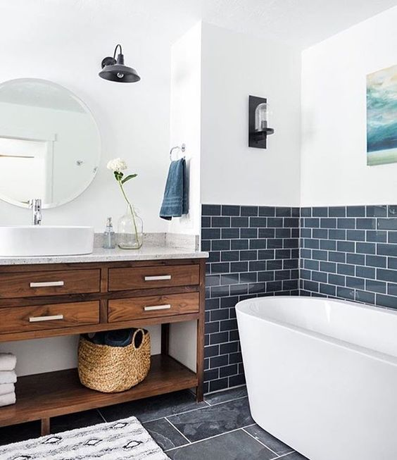 The Bathing E In This Rustic Bathroom Is Highlighted With Navy Subway Tiles