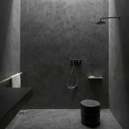 ultra-minimalist black shower space made with concrete