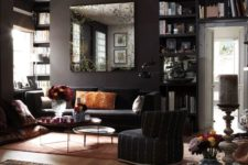 22 dark living room with black walls, colorful accessories and various textiles