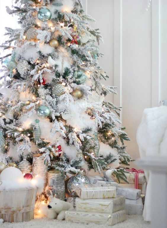 flocked christmas tree with white ornaments and lights flocked tree with gold and blue deocr