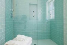 22 mint-colored subway wall tiles create a serene setting in this cozy bathroom